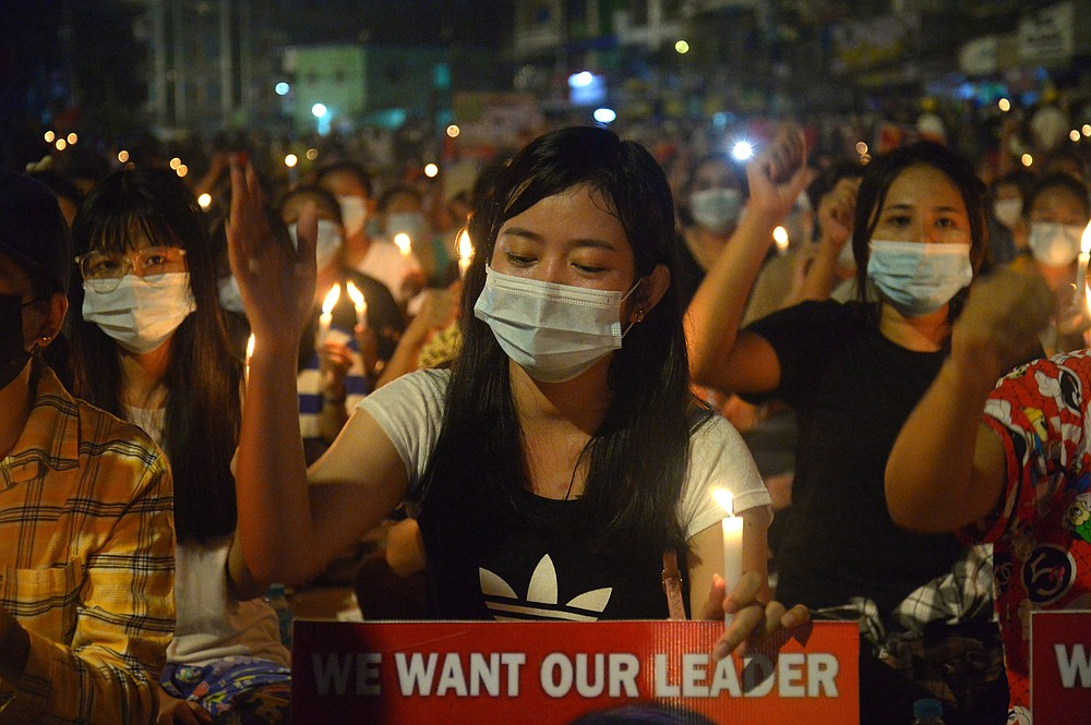 Protesters attend a candlelight night rally in Yangon, Myanmar, Saturday, Mar. 13, 2021. Security forces in Myanmar on Saturday again met protests against last month's military takeover with lethal force, killing at least four people by shooting live ammunition at demonstrators. (AP Photo)