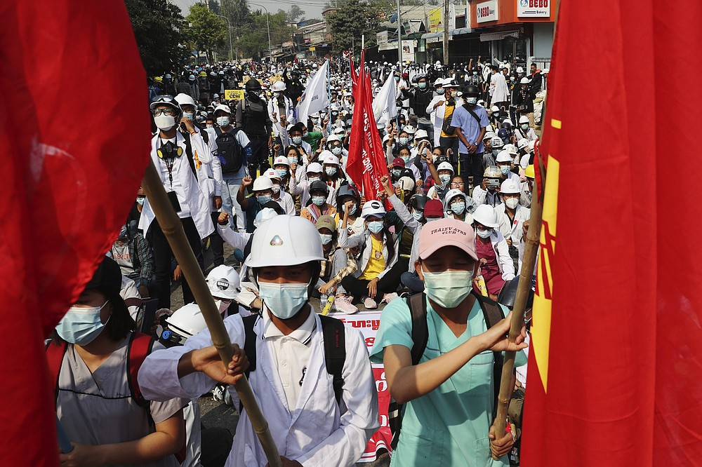 Protesters made up of teachers, medical students and other university students hold an anti-coup demonstration in Mandalay, Myanmar, Saturday, March 13, 2021. Myanmar's military seized power Feb. 1, hours before the seating of a new parliament following election results that were seen as a rebuff to the country's generals. (AP Photo)