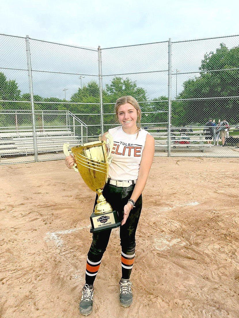 Submitted Photo/Lincoln rising ninth grader Brinkley Moreton holds the HFL summer championship softball trophy, which her travel ball team, the Tulsa Elite NWA06 24-25 won at Columbia, Mo. last weekend. Brinkley overcame a blood clot in her right arm,  weeks of being on blood thinners administered through shots in the belly, and predictions she wouldn't play softball this summer, through dogged determination and faith combined with that of her parents and church family to experience a miracle that put her back on the playing field. Next her team goes to Nationals at Florida.