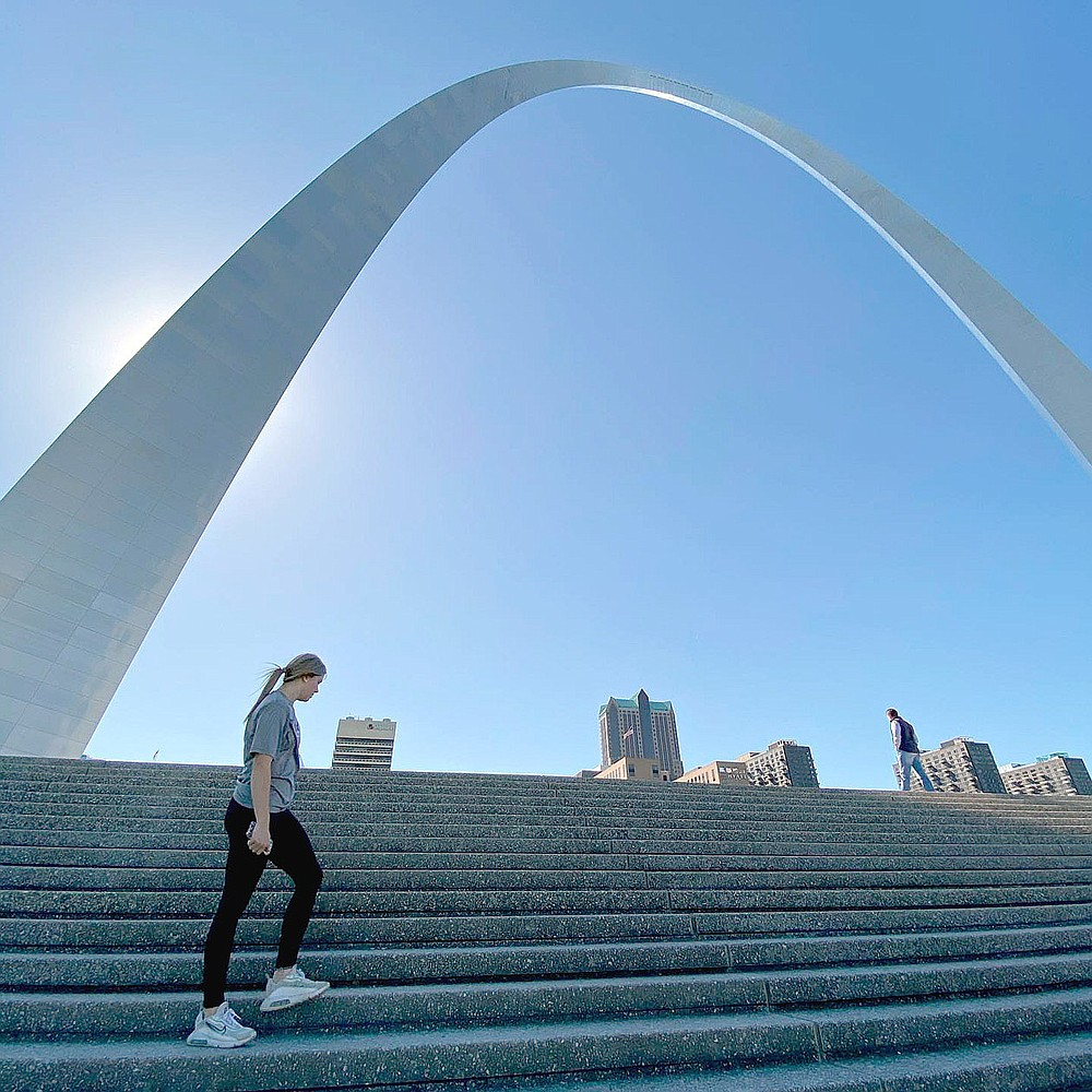 Submitted Photo/Lincoln rising ninth grader Brinkley Moreton stands in front of the Gateway Arch at St. Louis. Brinkley, daughter of Dax and Christina Moreton of Summers, was treated at Barnes Jewish Hospital, of St. Louis, which became the gateway for her miraculous return to competitive softball this summer after experiencing a blood clot in her right arm.