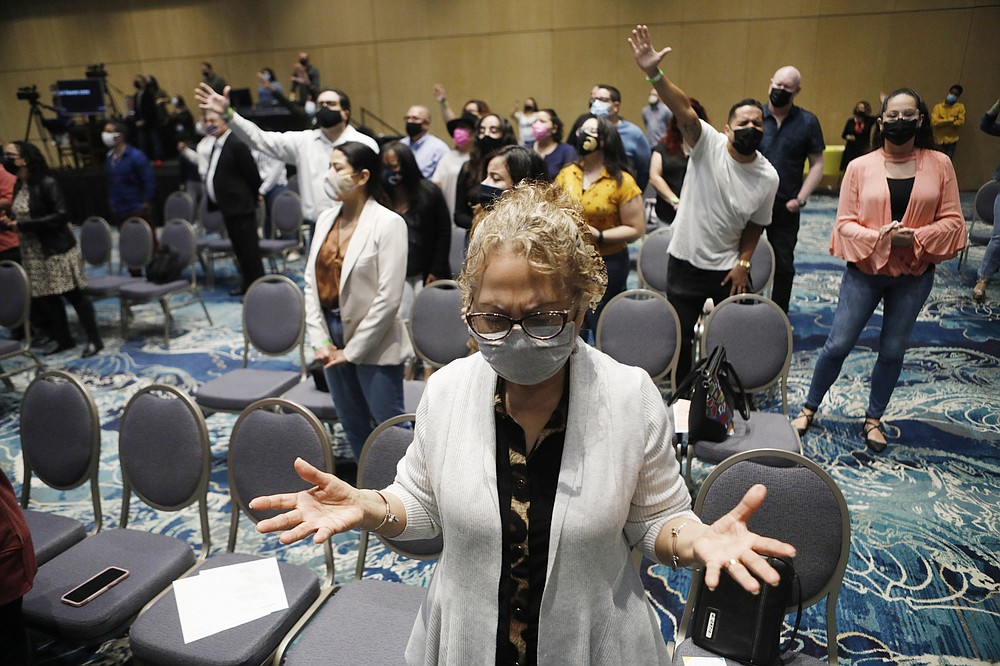 People attend a church service with the Rev. Gabriel Salguero at The Gathering Place in Orlando, March 7, 2021. ҉n getting yourself vaccinated, you are helping your neighbor,Ӡhe preached to about 300 masked and socially distanced worshipers. ҇od wants you to be whole so you can care for your community. So think of vaccines as part of Godճ plan.Ӡ(Octavio Jones/The New York Times)