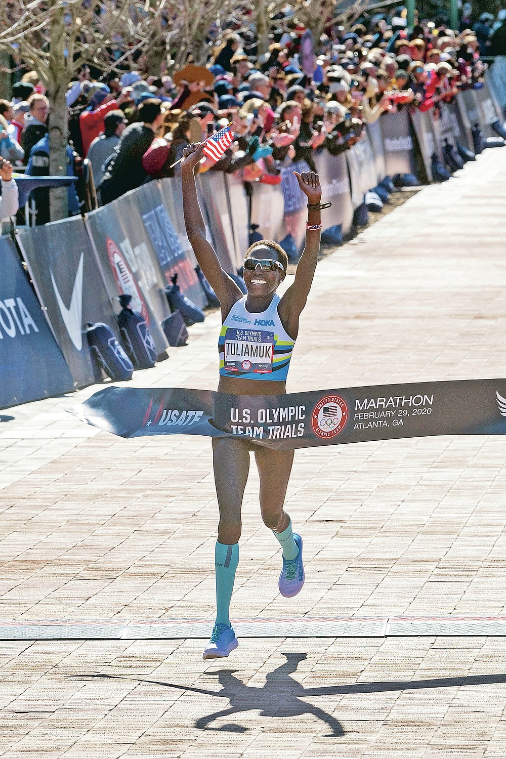FILE - Aliphine Tuliamuk crosses the finish line to win the women's U.S. Olympic marathon trials, Saturday, Feb. 29, 2020, in Atlanta. When the Tokyo Summer Games were postponed, U.S. Olympic marathon trials champion Aliphine Tuliamuk decided with her fiance last year to have a baby instead of waiting. (AP Photo/John Amis, File)