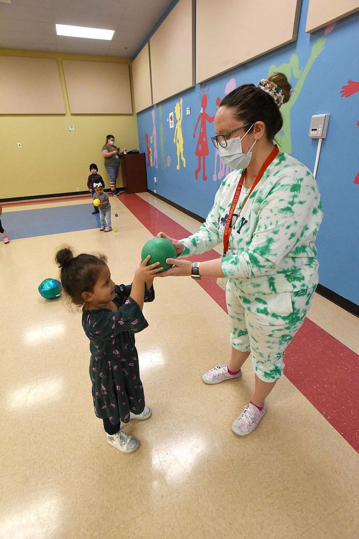 Teacher Katie Jennings plays with children on Wednesday March 17 2021 at the Benton County Sunshine School and Development Center. (NWA Demorcrat-Gazette/Flip Putthoff)