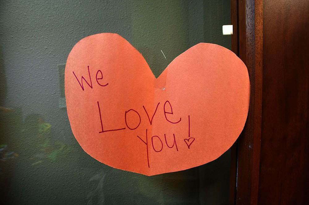 Staff artwork decorates hallways and doors throughout the school. (NWA Democrat-Gazette/Flip Putthoff)