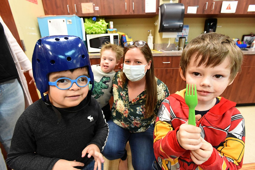 Sarah Pollack, in charge of philanthropy, plays with students on Wednesday March 17 2021 at the Benton County Sunshine School and Development Center in Rogers. (NWA Democrat-Gazette/Flip Putthoff)