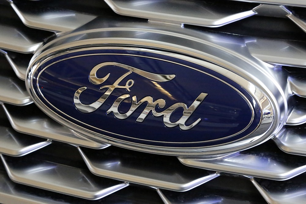 FILE- This Feb. 15, 2018, file photo shows a Ford logo on the grill of a 2018 Ford Explorer on display at the Pittsburgh Auto Show. Edsel B. Ford II is retiring from the board of Ford Motor after serving as a board member for 33 years. The automaker also named some other members of the famous family as board nominees. Board nominees will be up for election at Ford's annual meeting on May 13, 2021. (AP Photo/Gene J. Puskar, File)