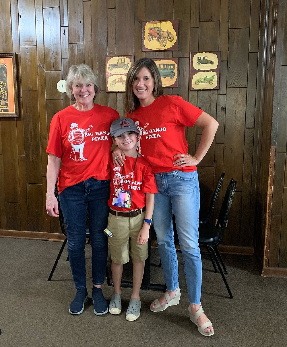 The Ratliff family, including Rita Ratliff (left), Brandy Ratliff Weatherly (right) and her son, Ethan Weatherly, still own Big Banjo Pizza, 4208 W. 28th Ave. (Special to The Commercial/Brandy Weatherly)