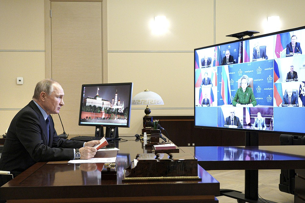 Russian President Vladimir Putin chairs a Security Council meeting via video conference at the Novo-Ogaryovo residence outside Moscow, Russia, Friday, March 12, 2021. (Alexei Druzhinin, Sputnik, Kremlin Pool Photo via AP)