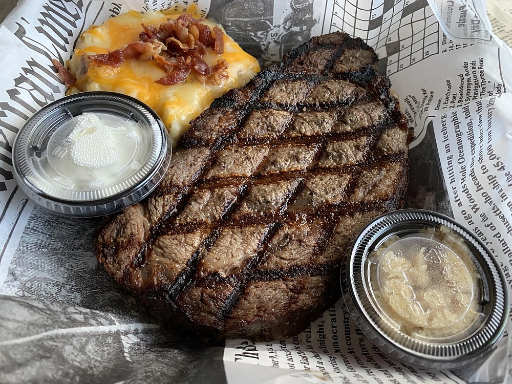 Shorty Small's grills, rather than roasts, its 15-ounce prime rib, and serves it (to go) with cheese-and-bacon-topped mashed potatoes and a side salad, plus cups of horseradish and sour cream. (Arkansas Democrat-Gazette/Eric E. Harrison)