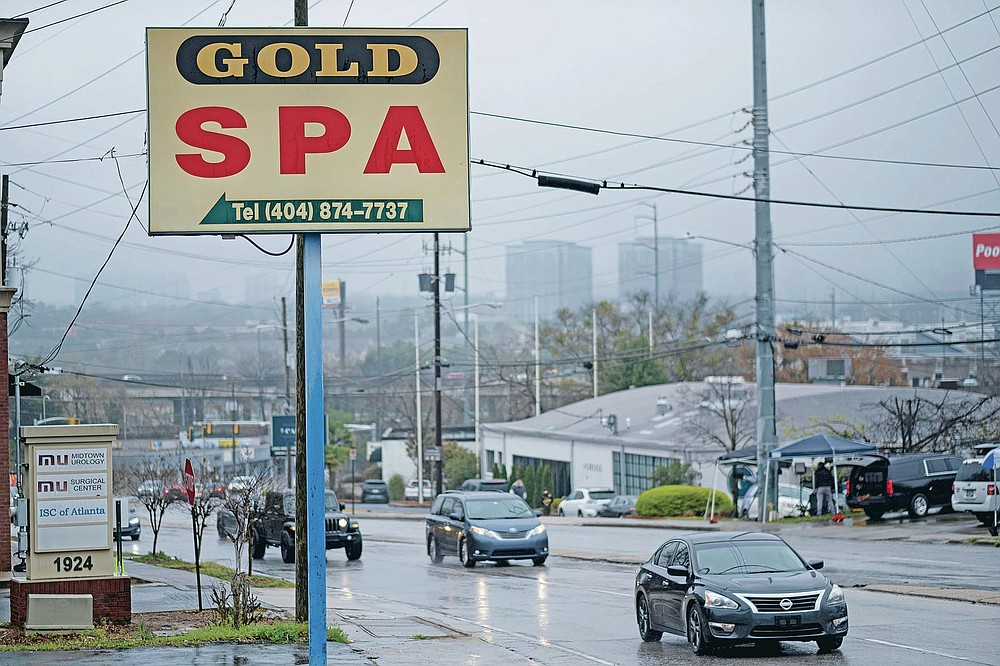 """FILE - This Wednesday, March 17, 2021 file photo shows a sign for the Gold Spa massage business in Atlanta, the day after multiple people were killed at three massage spas in the Atlanta area. On Friday, March 19, 2021, The Associated Press reported on stories circulating online incorrectly asserting that on Tuesday, March 16, hours before police say Robert Aaron Long, 21, killed eight people at three Atlanta-area massage businesses, he posted on his Facebook that China was engaged in a """"COVID coverup"""" and """"AMERICANS NEED TO FIGHT BACK AGAINST CHINA, NOW."""" But the post is not authentic. The fictitious image began circulating Tuesday night after Long, was identified as a suspect in the mass shootings that took place at the Atlanta-area massage businesses. (AP Photo/Ben Gray)"""
