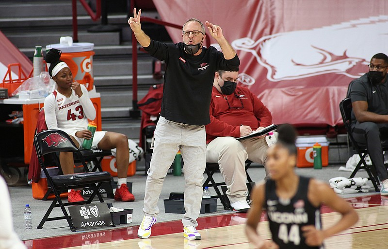 Arkansas women's head basketball coach Mike Neighbors gestures at his team during a Jan. 28 game against the Connecticut Huskies at Bud Walton Arena. The team faces off against Wright State today at 1 p.m. in the NCAA Division I Women's Basketball Tournament in Austin, Texas. - Photo by David Gottschalk of NWA Democrat-Gazette  nwasptboyduawomen20210129