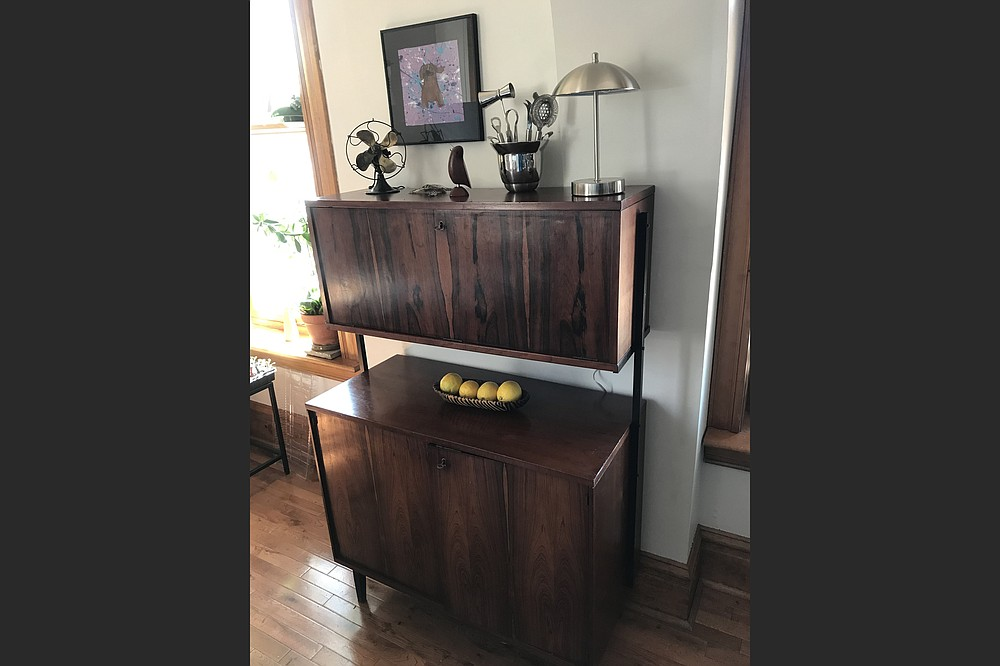 Valerie and Andy Hahn found the two pieces of this midcentury rosewood bar at a thrift store for $50 and fixed it up for a total cost of $96.  (TNS/St. Louis Post-Dispatch/Valerie Schremp Hahn)