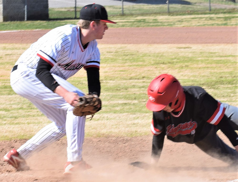RICK PECK/SPECIAL TO MCDONALD COUNTY PRESS McDonald County first baseman Weston Gordon looks too late to tag out a Grove runner on a pick-off attempt during the Mustangs' 6-4 win in the consolation finals of the Ozarks Baseball Classic on March 20 in Harrison, Ark.