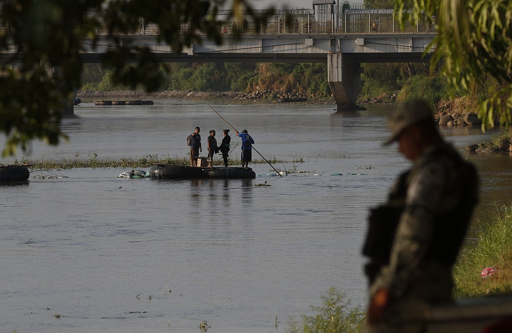 People travel across the Suchiate River, the natural border between Guatemala and Mexico, from Guatemala to Mexico, as Mexican immigration agents enforce limits on all but essential travel at its shared border, near Ciudad Hidalgo, Mexico, Monday, March 22, 2021. Mexican agents are forcing those with permission to enter Mexico to use the official border crossing bridge and others are being returned to Guatemala. (AP Photo/Eduardo Verdugo)