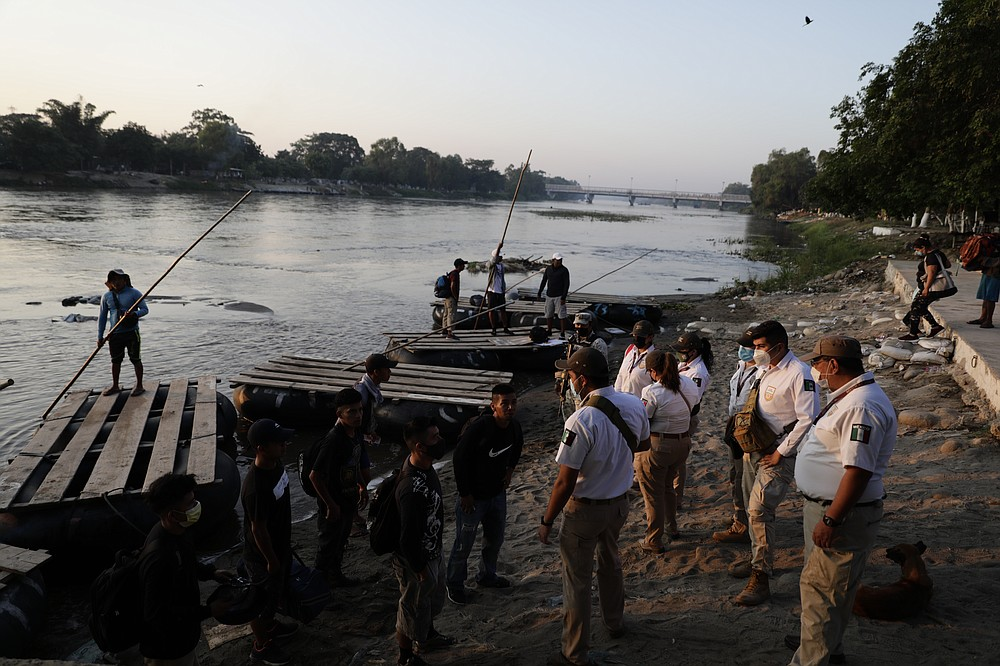 Mexican immigration agents stop people who crossed the Suchiate River, the natural border between Guatemala and Mexico, to see their identification documents near Ciudad Hidalgo, Mexico, Monday, March 22, 2021. Agents are forcing those with permission to enter Mexico for work or a visit to use the official border crossing bridge, and those who do not are being returned toGuatemala, as they enforce new limits on all but essential travel at its shared border with Guatemala. (AP Photo/Eduardo Verdugo)