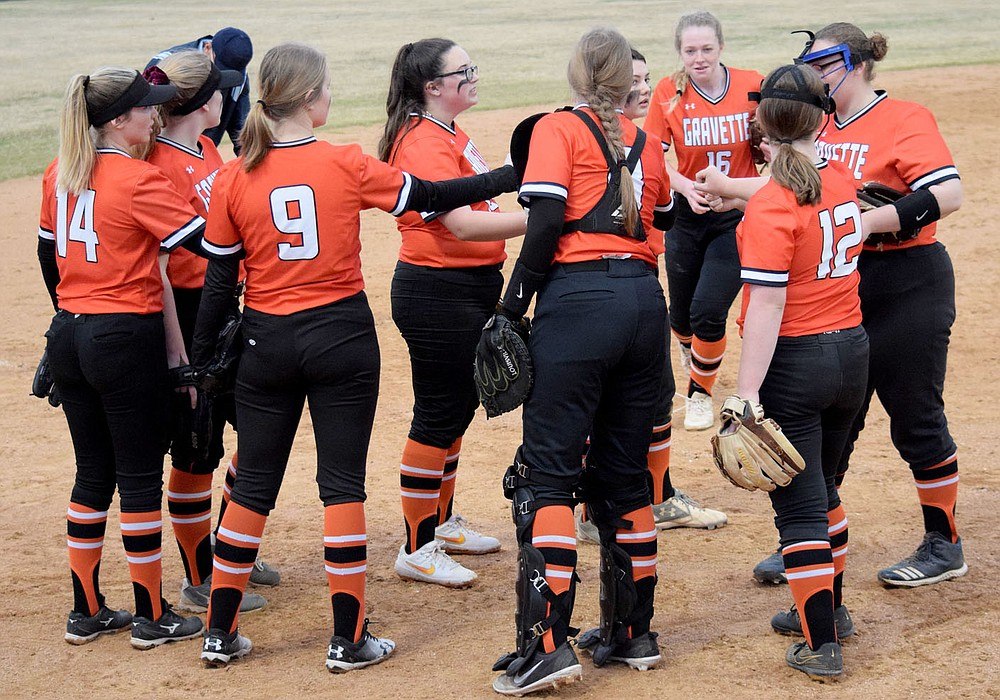 Westside Eagle Observer/MIKE ECKELS Members of the Lady Lion softball team gather near the pitcher's mound for a little last minute pep talk before taking their positions during the Gravette-Springdale softball contest in Gravette March 12.