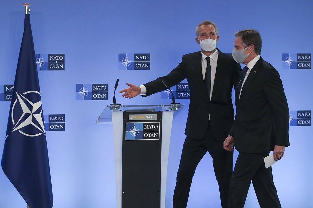 NATO prepares virus-free zone for summit; Biden invited
