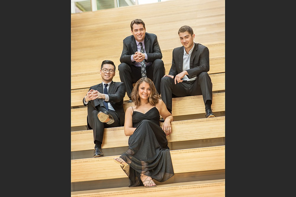 The Dover Quartet — (clockwise from left), Bryan Lee and Joel Link, violin; and Camden Shaw, cello; and Milena Pajaro-van de Stadt, viola — return to Fayetteville's Walton Arts Center for an Artosphere performance in May. (Special to the Democrat-Gazette/Carlin Ma)