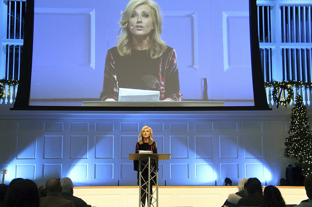 FILE - In this Thursday, Dec. 13, 2018 file photo, Beth Moore addresses a summit on sexual abuse and misconduct at Wheaton College in Wheaton, Ill. A Bible study teacher, Moore has been beloved among Southern Baptists for years, packing out stadiums and selling millions of books. But when she began to criticize Trump and call out sexism, racism, and abuse in the church, she became a pariah. In 2021, Moore left the nation's largest Protestant denomination, saying she can no longer identify as Southern Baptist. (Emily McFarlan Miller/Religion News Service via AP)
