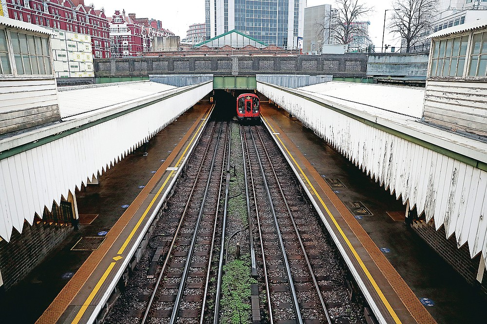 A tube train arrives at Edgware Road Underground station in London, Wednesday, March 10, 2021. Nicknamed the Tube, the Underground's staff from cleaners to train drivers take pride in maintaining a system that keeps London's heart beating. (AP Photo/Alastair Grant)