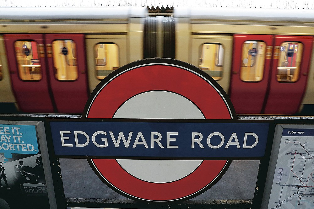 A tube train departs from Edgware Road Underground station In London, Wednesday, March 10, 2021. Even as many of its famous institutions closed during the coronavirus pandemic for most of the past 12 months, London's Underground kept running through three successive lockdowns. (AP Photo/Alastair Grant)