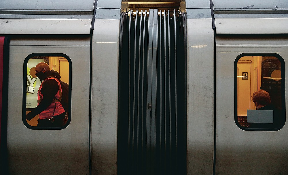 A tube driver walks through the carriages of his train at Edgware Road Underground station in London, Wednesday, March 10, 2021. (AP Photo/Alastair Grant)