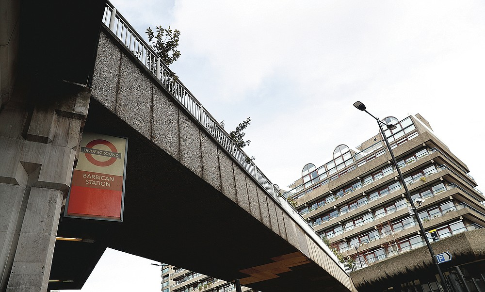 An exterior view outside Barbican Underground station in London, Friday, March 12, 2021. Before the nationwide lockdown a year ago, about 5 million journeys a day were taken on the Tube. Ridership plunged to just 4% of that early in the outbreak and now carries about a fourth of that. (AP Photo/Alastair Grant)