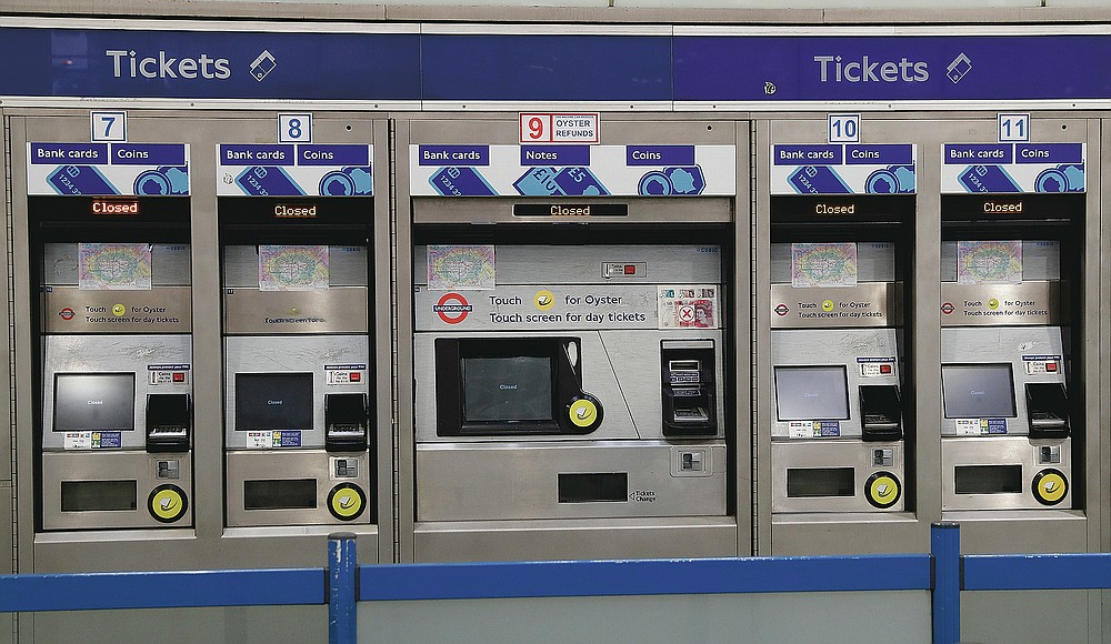 A bank of closed ticket machines stand idle at King's Cross Underground station in London, Friday, March 12, 2021. (AP Photo/Alastair Grant)