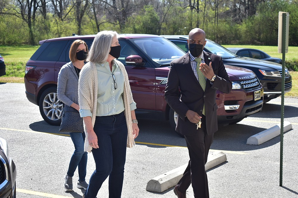 Samuel Glover, right, Pine Bluff Parks and Recreation director, gives a tour of the remodeled Pine Bluff Community Center to Cricket Wireless marketing manager Hayley Schaberg, left, and indirect sales executive Beth Burgess on Wednesday, March 24, 2021. (Pine Bluff Commercial/I.C. Murrell)
