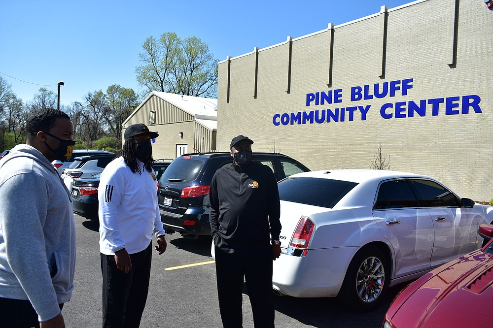 From left, UAPB men's basketball assistant coach Richard Cannon, assistant athletic director for academics Kyle Hartsfield and men's basketball head Coach George Ivory talk outside the Pine Bluff Community Center on Wednesday, March 24, 2021. (Pine Bluff Commercial/I.C. Murrell)