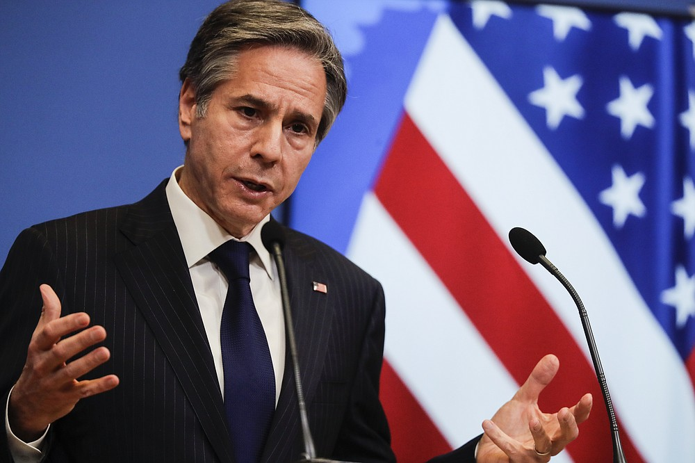 U.S. Secretary of State Antony Blinken speaks during a news conference at the end of a NATO Foreign Affairs Ministers meeting at NATO headquarters in Brussels, Wednesday, March 24, 2021. (Olivier Hoslet,/Pool Photo via AP)