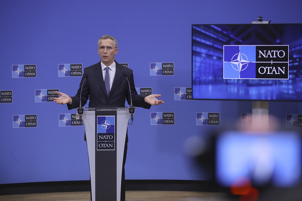 NATO Secretary General Jens Stoltenberg speaks during a news conference at the end of a NATO Foreign Affairs Ministers meeting at NATO headquarters in Brussels, Wednesday, March 24, 2021. (Olivier Hoslet/Pool Photo via AP)