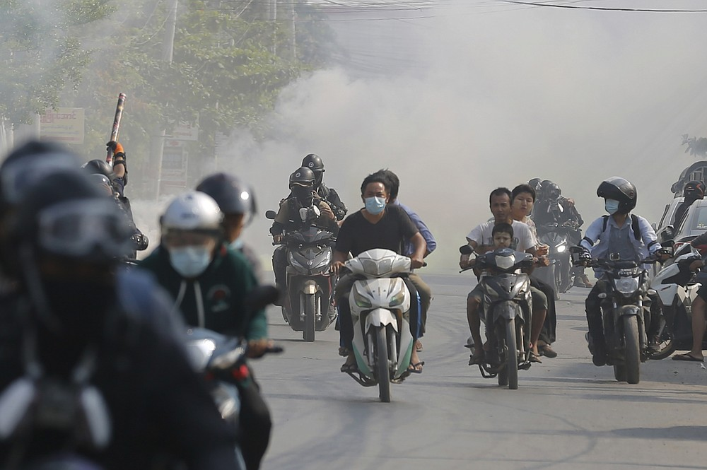 """Protesters drive their motorcycles during an anti-coup protest in Mandalay, Myanmar on Thursday March 25, 2021. Protesters against last month's military takeover in Myanmar returned to the streets in large numbers Thursday, a day after staging a """"silence strike"""" in which people were urged to stay home and businesses to close for the day. (AP Photo)"""