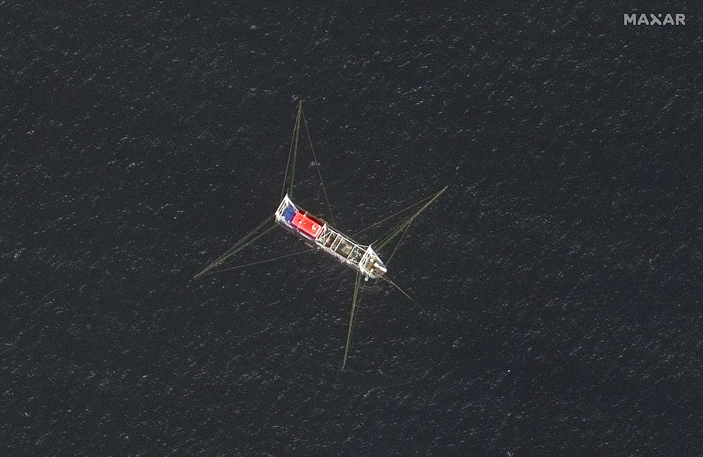 This satellite image provided by Maxar Technologies shows a Chinese fishing vessel in the Whitsun Reef located in the disputed South China Sea. Tuesday, March 23, 2021. The United States said Tuesday it's backing the Philippines in a new standoff with Beijing in the disputed South China Sea, where Manila has asked a Chinese fishing flotilla to leave a reef. China ignored the call, insisting it owns the offshore territory. (©2021 Maxar Technologies via AP)
