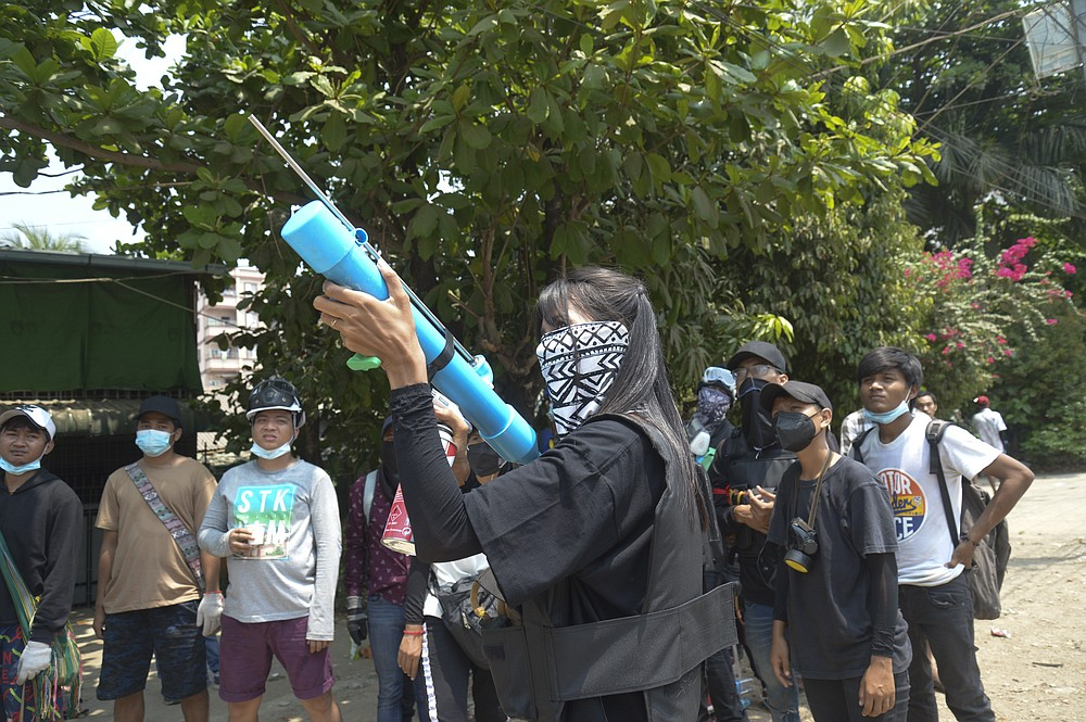 Anti-coup protesters prepare with makeshift airgun during police crackdown at Thaketa township in Yangon, Myanmar, Saturday, March 27, 2021. The head of Myanmar's junta has used the occasion of the country's Armed Forces Day to try to justify the overthrow of the elected government of Aung San Suu Kyi, as protesters marked the holiday by calling for even bigger demonstrations. (AP Photo)