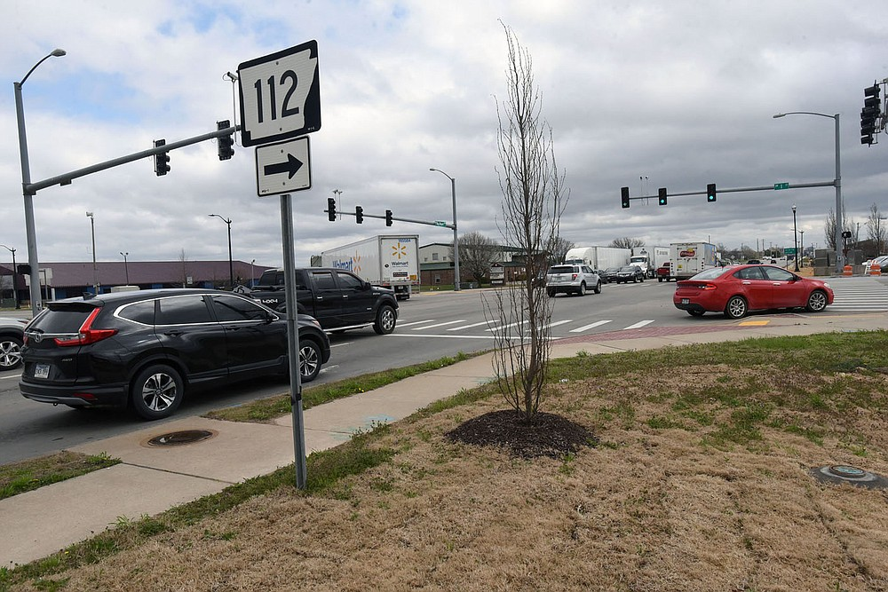 Traffic moves Tuesday March 23 2021 through the intersection of Southwest I Street and Southwest Regional Airport Boulevard in Bentonville. (NWA Democrat-Gazette/Flip Putthoff)
