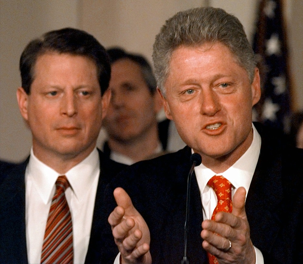 """FILE - In this Jan. 14, 1998, file photo as Vice President Al Gore looks on, President Clinton talks in the Grand Foyer of the White House in Washington about his proposed patient """"bill of rights"""" to guard against abuses in managed-care health plans. (AP Photo/Ruth Fremson, File)"""
