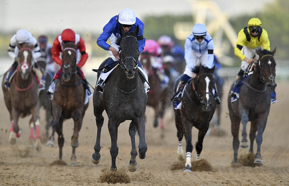 Rebel's Romance with jockey William Buick wins $750,000 Group 2 UAE Derby over 1900m (9.5 furlongs in Dubai, the United Arab Emirates, Saturday, March 27, 2021. (AP Photo/Martin Dokoupil)