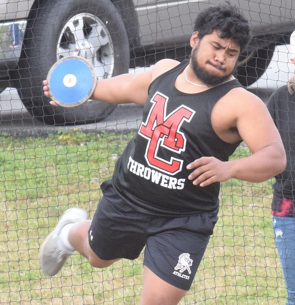 RICK PECK/SPECIAL TO MCDONALD COUNTY PRESS McDonald County's Junior Eliam picked up the Mustangs only win with a first place finish in the discus at the McDonald County Stancell Stampede held on March 25, at McDonald County High School to help the boys' team take third place in the team race.