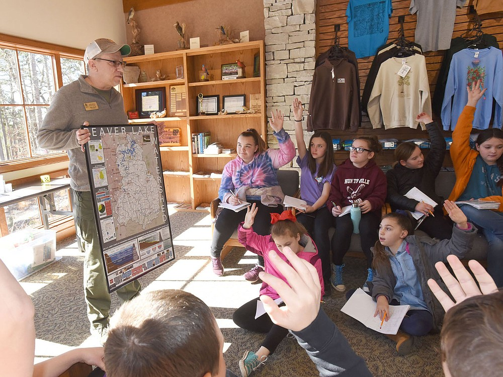 NWA Democrat-Gazette/FLIP PUTTHOFF  PRECIOUS WATER Chris Pistole, park interpreter at Hobbs State Park-Conservation Area, teaches Tuesday March 5 2019 a lesson on surface water and ground water to students from Huntsville Intermediate School at the park's visitor center. Students studied environmental subjects and did exercises to compliment the lessons. The field trip was funded in part by the Arkansas Humanities Council, said Terri Kennedy, science facilitator for the school.