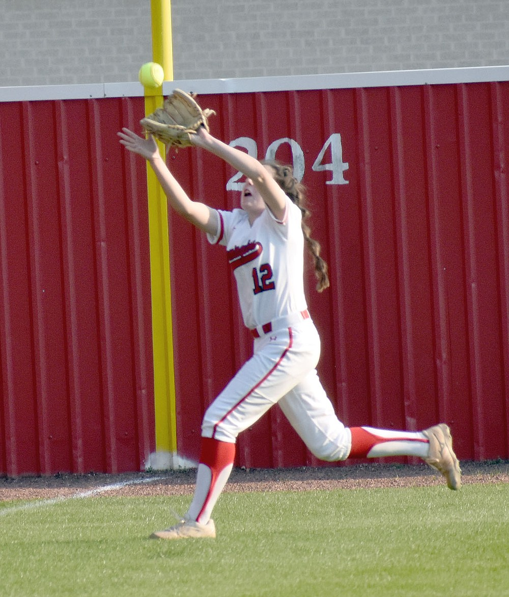MARK HUMPHREY  ENTERPRISE-LEADER/Farmington freshman Mary Lauren Bradley makes a catch in left field on the run. Farmington coach Randy Osnes inserted several reserves and still found a way to knock off previously unbeaten Bentonville West, 9-7, on Monday, March 29.
