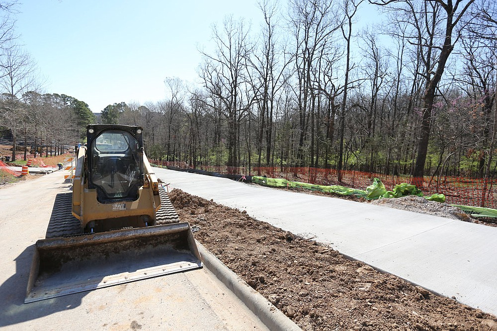 A new sidewalk is visible as infrastructure work continues Thursday, April 1, 2021, on the first phase of the development on Markham Hill near the intersection of Markham Road and Cross Avenue in Fayetteville. Check out nwadg.com/photos for a photo gallery. (NWA Democrat-Gazette/David Gottschalk)