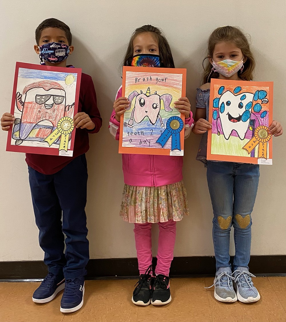Gandy Elementary School first grade winners in the Dental Health Art Contest are Ethan Tatum, Aryanna Chowdhury and Ella Lawson. (Special to The Commercial)