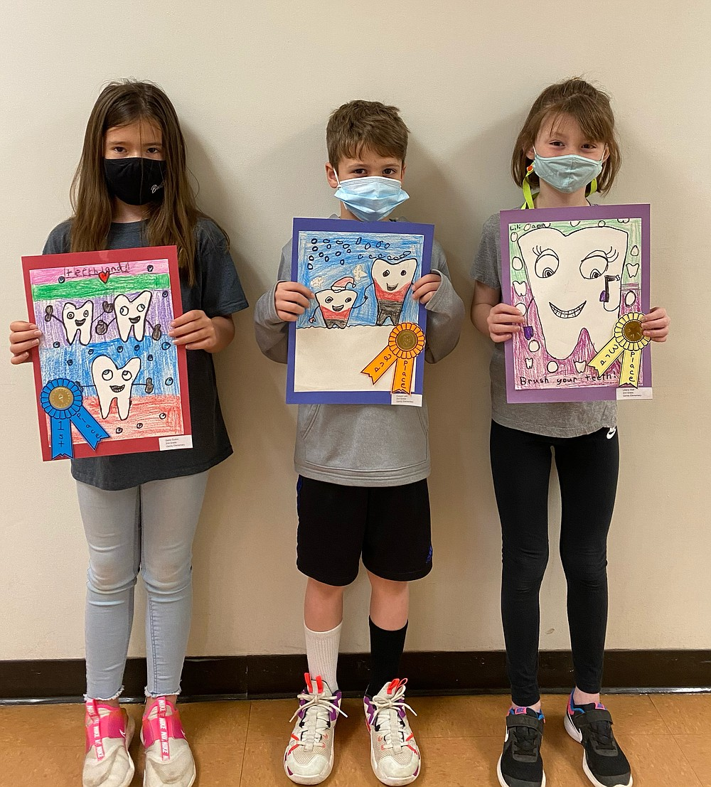 Gandy Elementary School second grade winners in the Dental Health Art Contest are Sadie Dutton, Cooper Law and Liliana Wall. (Special to The Commercial)