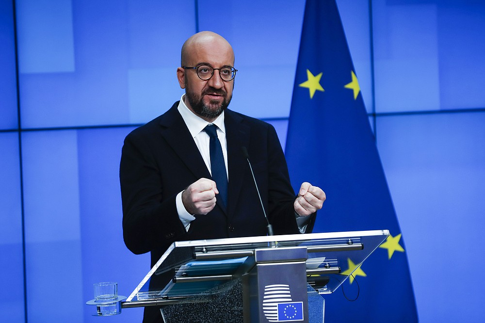 European Council President Charles Michel speaks during an online joint press conference with Director General of the World Health Organization Tedros Adhanom Ghebreyesus at the European Council headquarters in Brussels, Tuesday, March 30, 2021. (AP Photo/Francisco Seco, Pool)