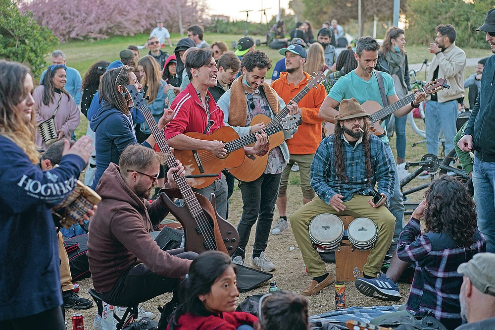 Local people play their instruments as they gather at a public park in Barcelona, Spain, Sunday, March 28, 2021. (AP Photo/Emilio Morenatti)