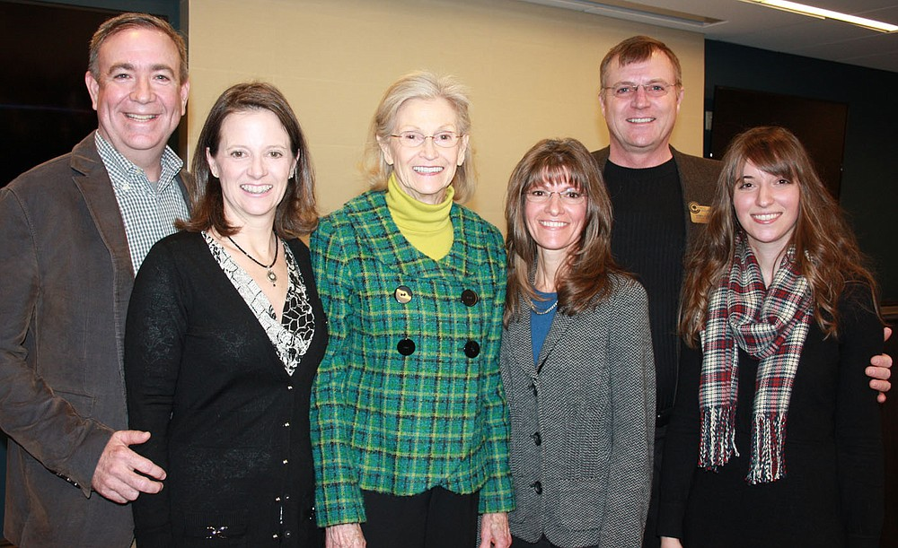 STAFF PHOTO CARIN SCHOPPMEYER Lamar and Shari Steiger, from left, Melba Shewmaker, Dayle and Dan Shewmaker and Amy Benincosa gather at the gand opening of the National Child Protection Training Center on Feb. 6 on the NorthWest Arkansas Community College campus in Bentonville.