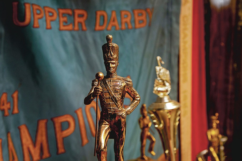 Trophies are displayed from over the decades at the Archer-Epler VFW Post 979 in Upper Darby, Pa., March 15, 2021. The post houses Bill Ives' collection of over 24,000 marching band and drum and bugle corps memorabilia. He was inducted into the World Drum Corps Hall of Fame in 2018. (Tom Gralish/The Philadelphia Inquirer via AP)