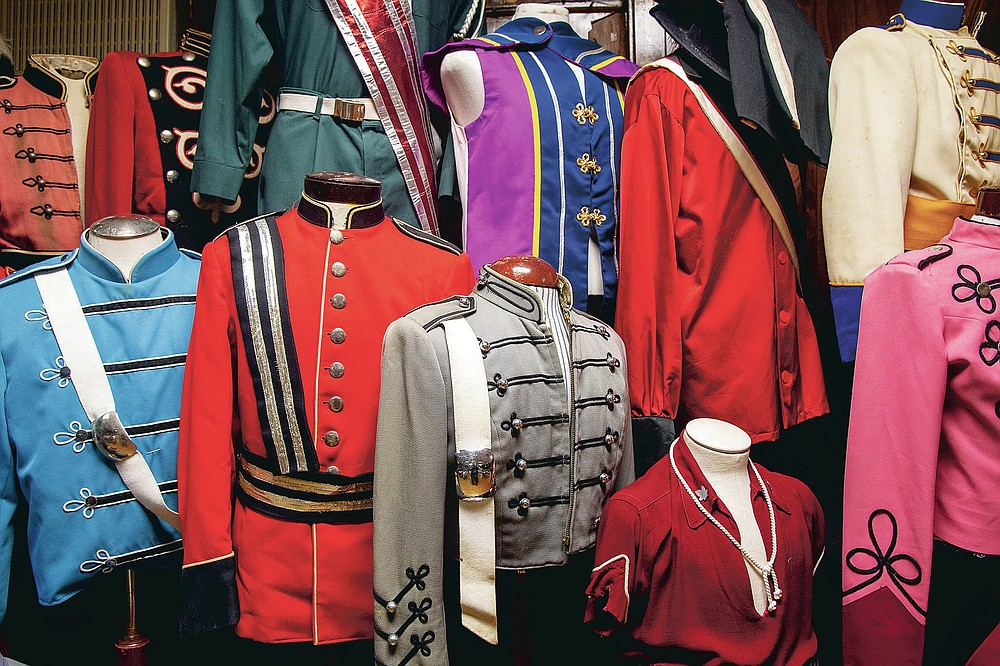 """Some of the hundreds of uniforms collected by Bill Ives are on display at the Archer-Epler VFW Post 979 in Upper Darby, Pa., March 15, 2021. """"The oldest uniform we have is from American Legion SAL Post 344 of Jeanette, Pa., in 1924,"""" said Ives, 63, who's been marching in drum corps since his Kensington childhood. """"Now I've got 350 uniforms. Everything has been donated."""" (Tom Gralish/The Philadelphia Inquirer via AP)"""