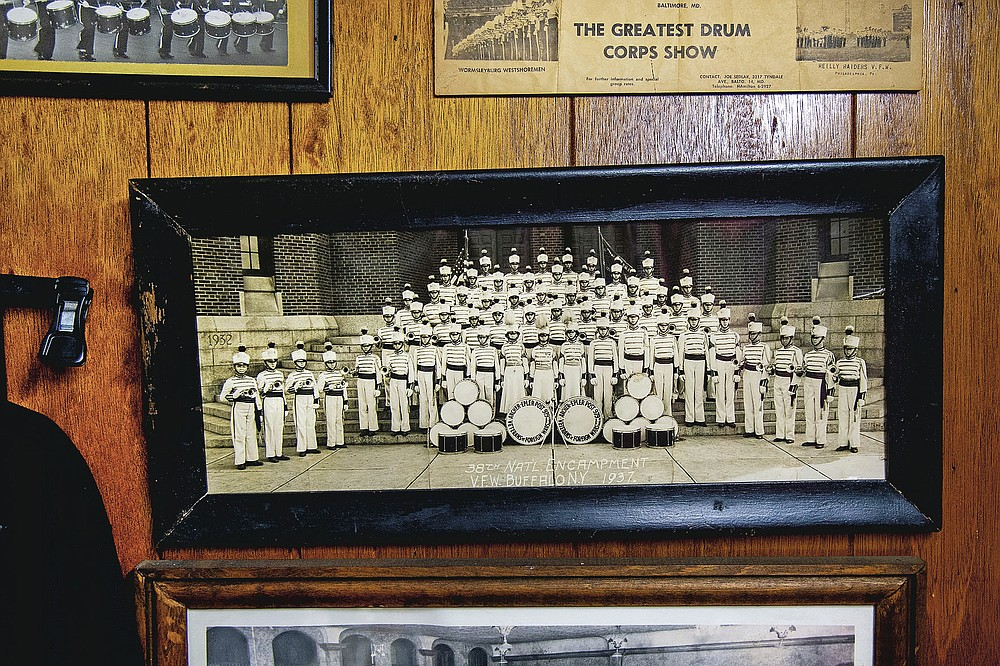 A photo of the Archer-Epler VFW Post 979 Musketeers Drum and Bugle Corps at the 1937 National Corps Encampment in Buffalo, N.Y., hangs on the wall at the post in Upper Darby, Pa., March 15, 2021. The post houses Bill Ives' collection of over 24,000 marching band and drum and bugle corps memorabilia. He was inducted into the World Drum Corps Hall of Fame in 2018. (Tom Gralish/The Philadelphia Inquirer via AP)